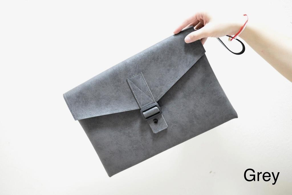 Leather clutch/ laptop bag